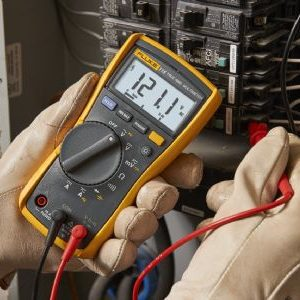 Hands using the Fluke-115 true rms multimeter