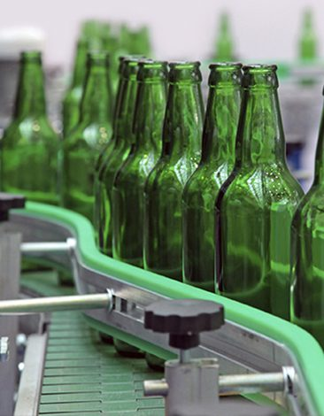 Bottles in a line on a conveyor belt